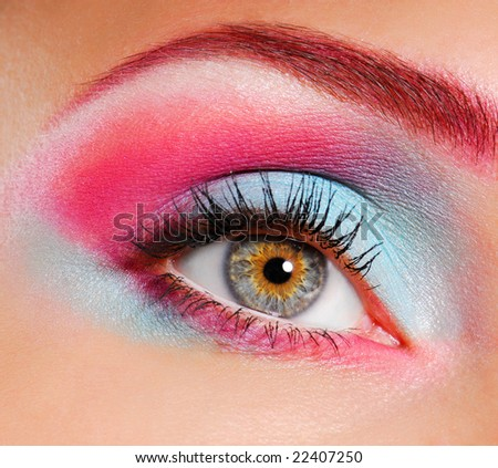 Elegance close-up of woman's eye with multicolored eyeliner and eyeshadow