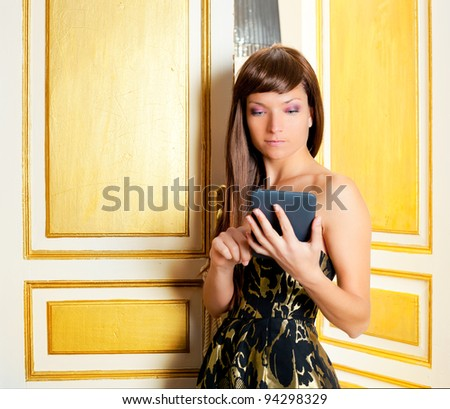 elegance fashion woman reading ebook tablet in golden door