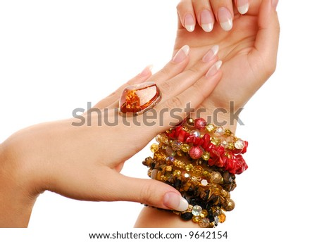 Elegance woman fingers and nails. Jewelry and gems.