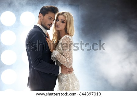 Elegant and attractive couple in the night club