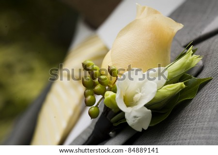 Elegant and classy boutonniere with amazing cream colored rose - stock photo