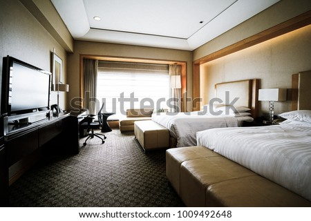 Elegant and comfortable home & hotel bedroom interior. #1009492648