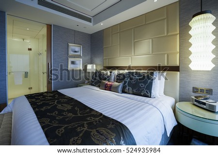 Elegant and comfortable home & hotel bedroom interior. #524935984