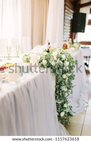 Elegant and elegant decoration and service of the wedding table #1157623618