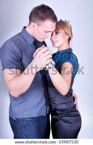 Elegant and happy romantic dancing couple, studio shot