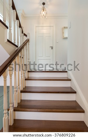 elegant and wooden stairs in...