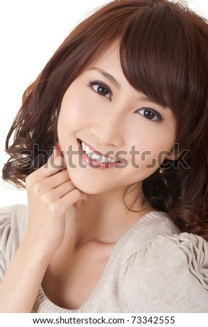 Elegant Asian woman smiling and looking at you, closeup portrait of beauty.