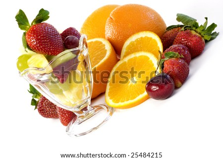 Elegant assorted fruit with glass parfait diagonal isolated on a white background with copy space