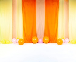 Elegant backdrop made with fabric velvet rolls and balloons for studio photo backdrop