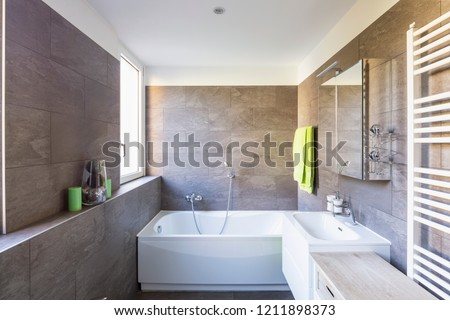 Elegant bathroom with dark tiles. Nobody inside