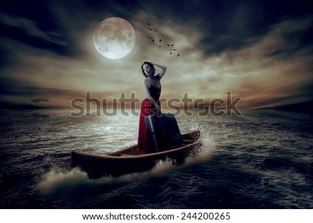 Elegant beautiful stylish woman with suitcase standing on a boat in a middle of the ocean after storm drifting away from her past on moonlight sky clouds background. Conceptual landscape screen saver