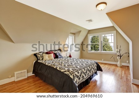 Elegant bedroom interior  in light ivory tone Furnished with bed in brown and white bedding with pillows