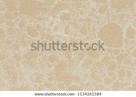 Elegant beige synthetic stone background in your admirable tone. High resolution photo. #1134261584