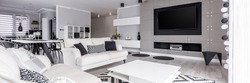 Elegant, black and white relax zone with home cinema system
