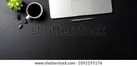 Elegant black office desktop with laptop and  cup of coffee. Top view #1092195176