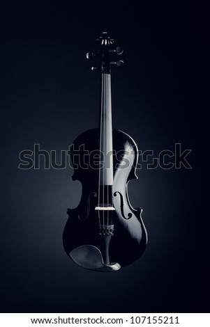 Elegant black violin on deep blue background