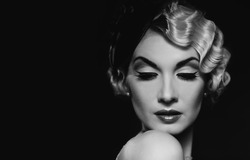 Elegant blond retro woman  wearing little hat with beautiful hairdo and red lipstick