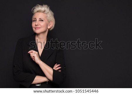 Elegant blonde beautiful middle aged lady posing,smiling to the camera. Attractive businesswoman. #1051545446