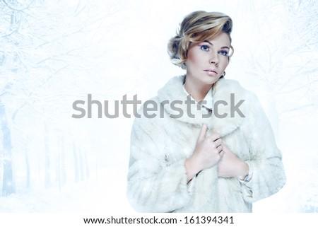 Elegant blonde woman wearing fur coat  in a winter weather concept