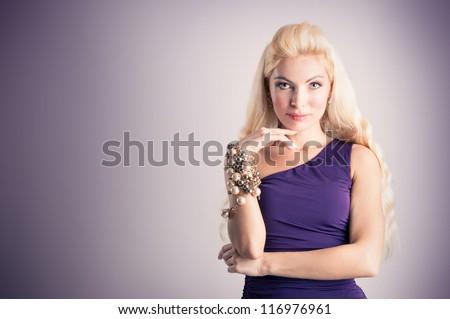 Elegant blonde woman with purple dress.
