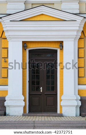Elegant Front Doors http://www.shutterstock.com/pic-42372751/stock-photo-elegant-brown-front-door-on-the-yellow-wall.html