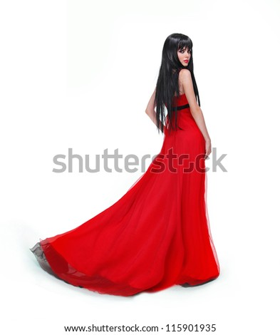 Elegant brunette girl posing in red gorgeous dress isolated on white