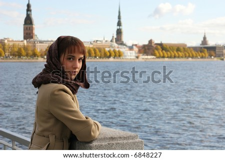 Elegant brunette woman on the riverbank