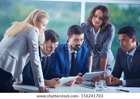 Elegant business partners planning work at meeting