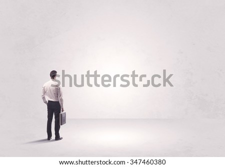 Elegant business person standing with his back looking at big empty white space concept #347460380