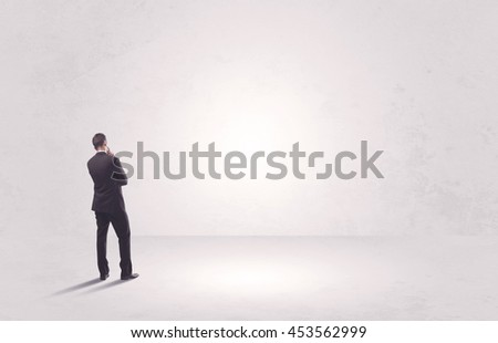 Elegant business person standing with his back looking at big empty white space concept #453562999