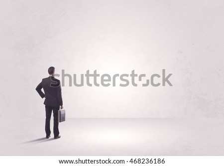 Elegant business person standing with his back looking at big empty white space concept #468236186