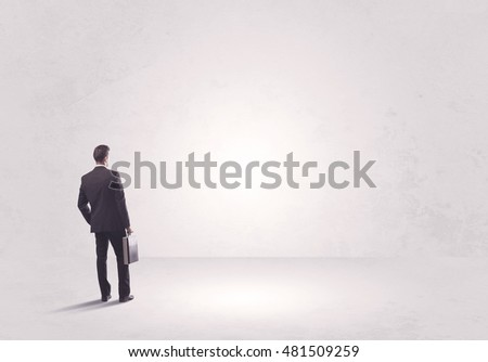Elegant business person standing with his back looking at big empty white space concept #481509259