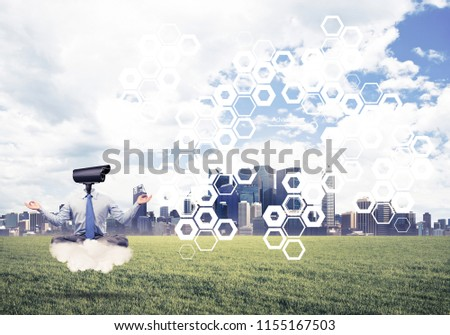 Elegant businessman outdoors floating on cloud and camera instead of head #1155167503