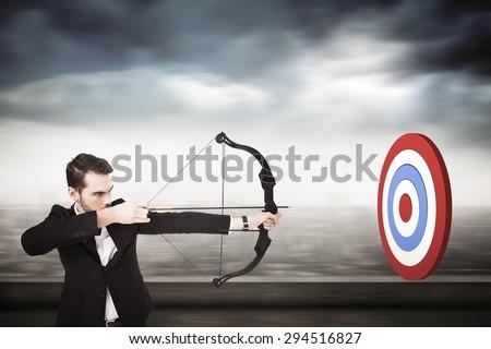 Elegant businessman shooting bow and arrow against cityscape