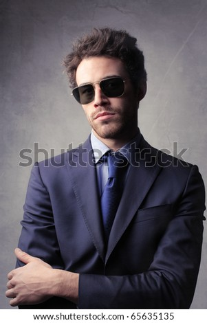 Elegant businessman wearing sunglasses