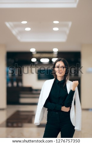 Elegant Businesswoman Casually Wearing Jacket on Shoulders. Corporate powerful female executive standing in office building