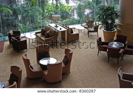 Elegant cafe lounge waiting area with tables and sofas