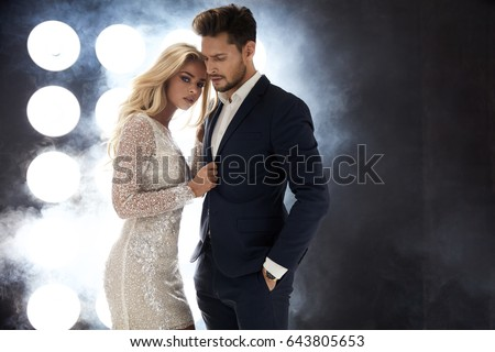 Shutterstock Elegant celeb couple posing on the stage