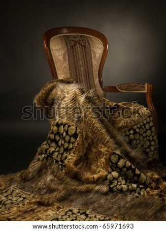 Elegant chair with a fur blanket