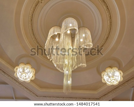 Elegant chandeliers  on the ceiling of a luxury restaurant. Chandeliers.  Luxury chandeliers.