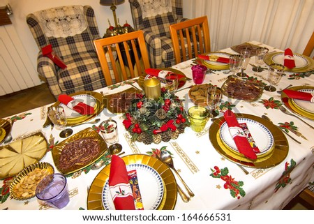 elegant Christmas table decorated with typical and colorful objects #164666531