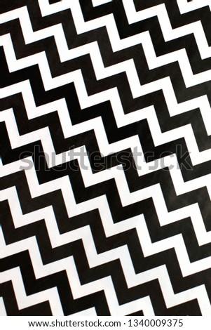 Elegant classic abstract chevron pattern background. White and black zigzag background. Fashion background #1340009375