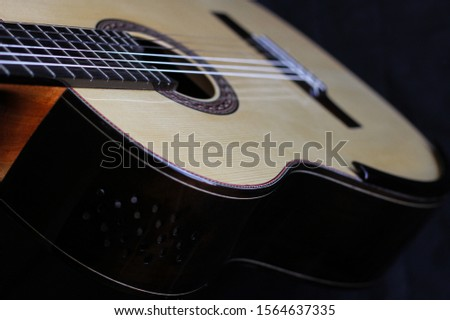 Elegant classical guitar with spruce top, ebony fretboard, arm rest and bridge,  guayacan sides with sound port holes