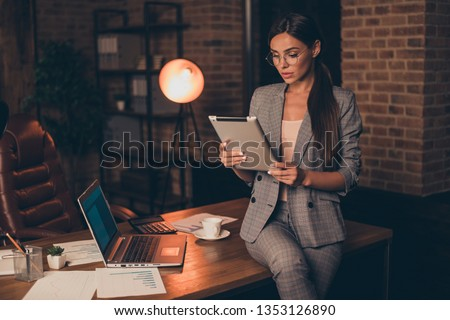 Elegant classy chic gorgeous attractive lovely smart clever lady executive director company founder reading finance report at industrial loft interior style indoors work place space #1353126890
