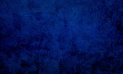 Elegant cobalt blue wall colour stylish and contemporary background. Texture wall grunge abstract background of indigo or navy blue dark. Stylized loft-style empty backdrop. Space for Text.
