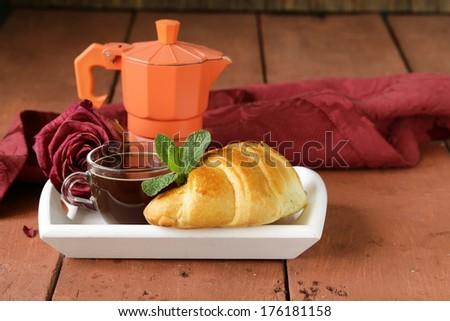 elegant coffee break or breakfast cup of coffee and croissant #176181158
