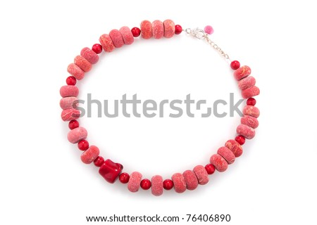 Elegant coral necklace, isolated on white - stock photo