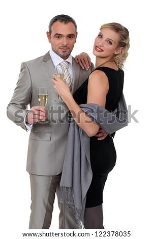 Elegant couple celebrating with champagne