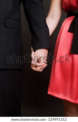 Elegant couple  holding by hands valentines day