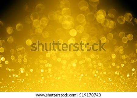 Elegant dark black gold glitter sparkle confetti glitz background or golden bling party invite for happy birthday, anniversary, wedding, new year's eve night or Christmas evening celebration